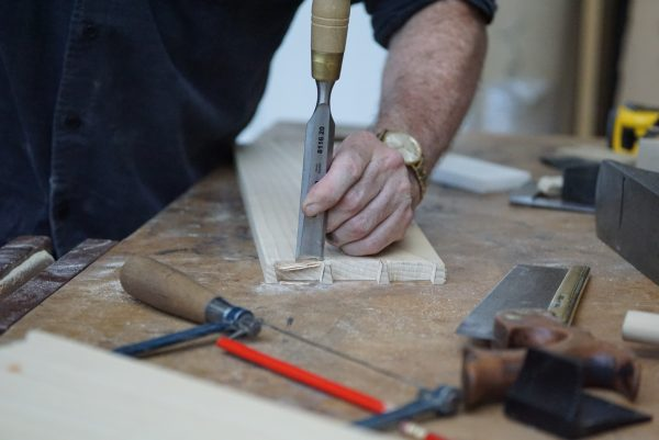 sam brown furniture maker working on some hand cut dovetails