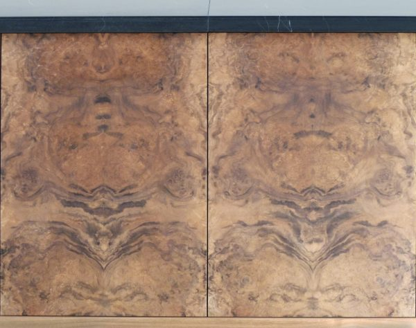 Beautifully book-matched veneers on the credenza doors